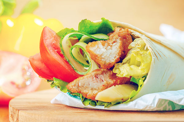 Chicken wrap with lettuce and tomatoe
